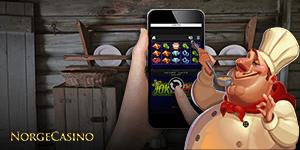 kokk og hånd som spiller på mobil