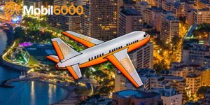 mobil6000 fly som flyr over storby
