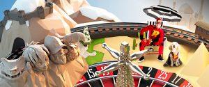 roulettehjul med rizk maskotene på og deler av fjell og strand
